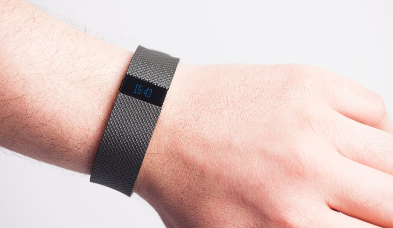 Bucharest, Romania - November 29, 2016:  Fitbit Charge HR is the new sport fitness tracker that can allow to track your daily activity, calories burned, sleep and weight. And It provides a online and mobile dashboard to check the progress