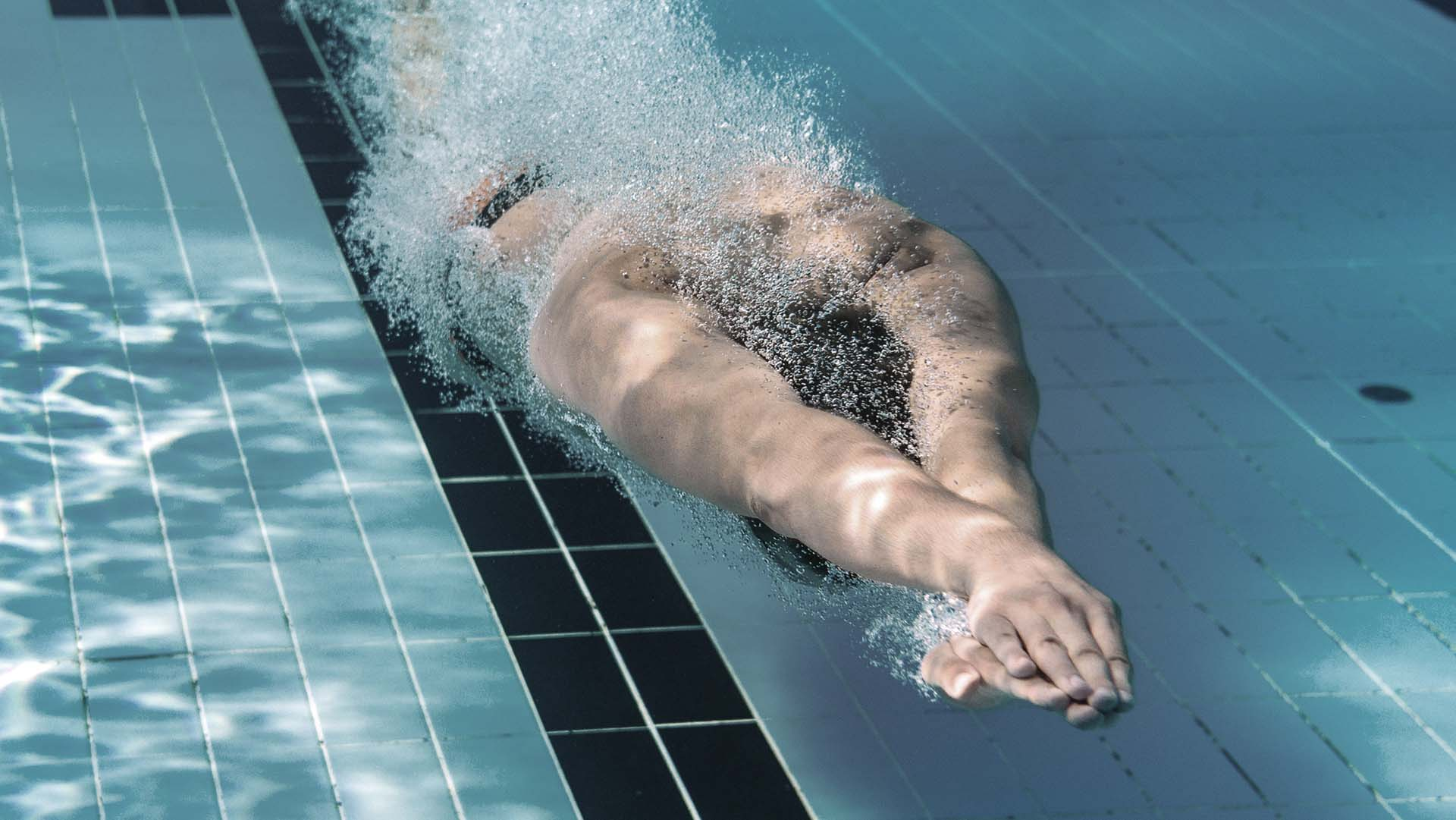 Male swimmer propelling underwater in the swimming pool