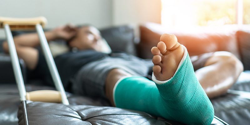 Image of person with leg in cast and crutches
