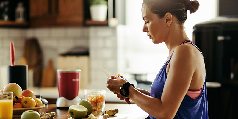 a woman preparing healthy foods