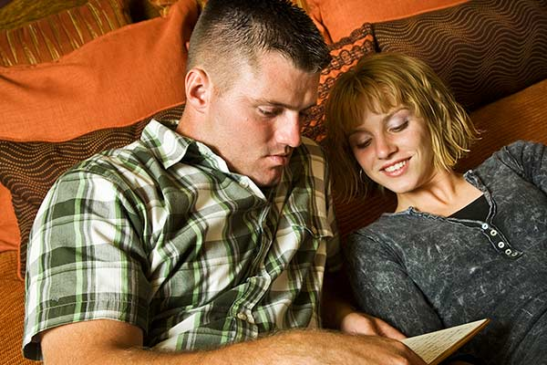 A couple researching their cover