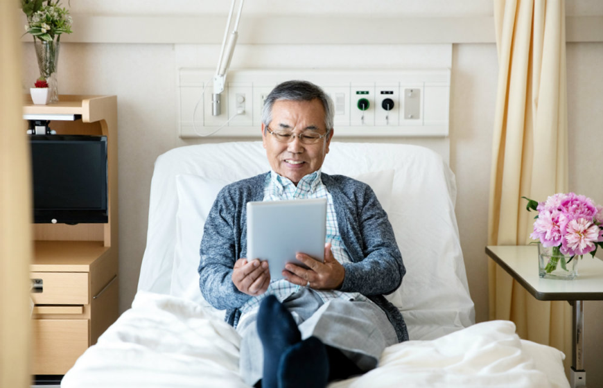 A man resting on his hospital bed