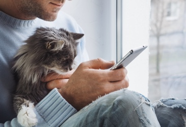 Man and cat with pet insurance